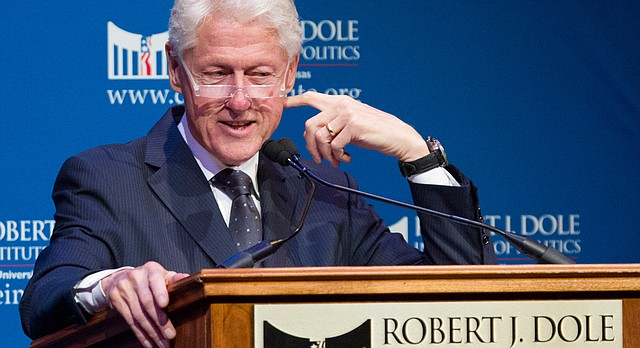 Former U.S. President Bill Clinton speaks Monday, Nov. 23, 2015, at the Lied Center of Kansas. Clinton was honored with the 2015 Dole Leadership Prize at the event, which was held by the Dole Institute of Politics.