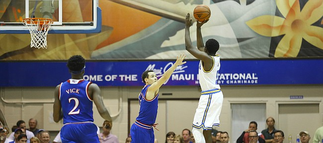 Kansas guard Evan Manning (5) stretches to defend against a shot from UCLA guard Prince Ali (5) during the second half, Tuesday, Nov. 24, 2015 at Lahaina Civic Center in Lahaina, Hawaii.