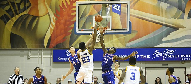 Kansas forward Jamari Traylor (31) and Kansas forward Hunter Mickelson (42) look to defend against a shot by UCLA forward Tony Parker (23) during the second half, Tuesday, Nov. 24, 2015 at Lahaina Civic Center in Lahaina, Hawaii.