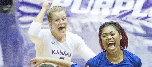 Kansas' Ainise Havili (11), Tiana Dockery (7) and Cassie Wait celebrate a point during their volleyball match against Kansas State Wednesday evening at Ahearn Field House. The Jayhawks defeated the Wildcats in four sets to improve their record to 25-2 on the year.