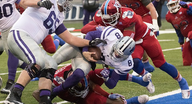 Kansas' Marcquis Roberts, right, and Fish Smithson are unable to keep Kansas State junior quarterback Joe Hubener (8) out of the end zone during the annual Sunflower Showdown game Saturday at Memorial Stadium.