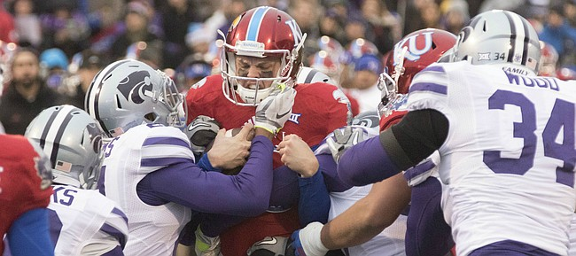 Kansas freshman quarterback Ryan Willis is stood up on third and one by the Kansas State defense for a one yard loss during the annual Sunflower Showdown game Saturday at Memorial Stadium.
