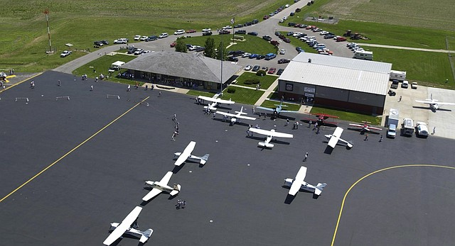 In this 2009 file photo of Lawrence Municipal Airport, several vintage and modern aircraft are on display.