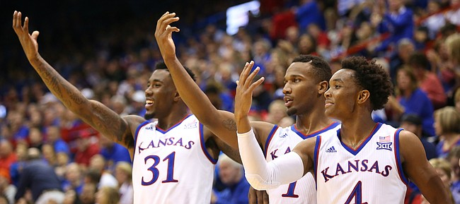 Kansas teammates Devonte' Graham (4), right, Wayne Selden Jr. (1) and Jamari Traylor (31) mimic a finger roll delivery by teammate Kansas guard Sviatoslav Mykhailiuk (10) during the second half, Tuesday, Dec. 1, 2015 at Allen Fieldhouse.