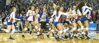 Kansas players rush the court following their three set sweep of Missouri in the second round of the NCAA volleyball tournament Friday evening at the Horejsi Center.