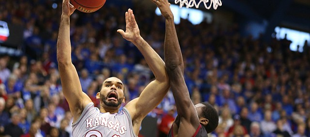 Kansas forward Perry Ellis (34) glides in for a bucket against several Harvard defenders during the second half, Saturday, Dec. 5, 2015 at Allen Fieldhouse.