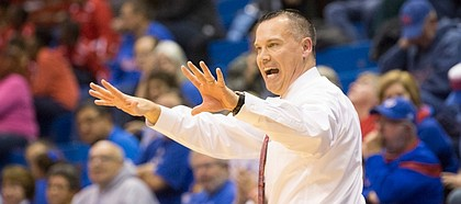 Kansas university coach Brandon Schneider motions to his players during Kansas' Nov. 19 game against Memphis at Allen Fieldhouse.