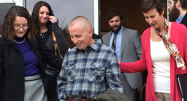 Floyd Bledsoe, center, walks out of Jefferson County District Court on Tuesday, Dec. 8, 2015, after a judge released him from prison and overturned his April 2000 conviction in a first-degree murder case. Accompanying Bledsoe are Kansas University Innocence Project attorneys Jean Phillips, left, and Elizabeth Cateforis, right.