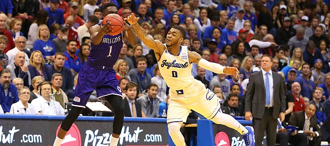 Kansas guard Frank Mason III (0) nearly intercepts a pass to Holy Cross forward Karl Charles (1) during the first half, Wednesday, Dec. 9, 2015 at Allen Fieldhouse.