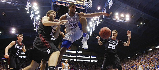 Kansas forward Landen Lucas (33) fights for a loose ball with Harvard guard Patrick Steeves (10) under the bucket during the second half, Saturday, Dec. 5, 2015 at Allen Fieldhouse.