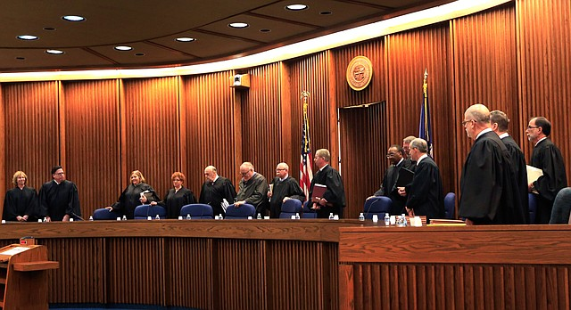 The full 14-member of the Kansas Court of Appeals enter the Supreme Court courtroom in Topeka, Kan., to hear oral arguments Wednesday, Dec. 9, 2015. The lawsuit against a Kansas ban on a common second-trimester procedure has forced the state Court of Appeals to consider how much the state constitution protects abortion rights.