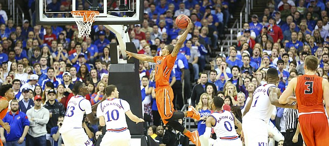 Oregon State guard Gary Payton II (1) elevates for a thunderous dunk against Kansas forward Cheick Diallo (13) and guard Sviatoslav Mykhailiuk (10) during the first half, Saturday, Dec. 12, 2015 at Sprint Center.