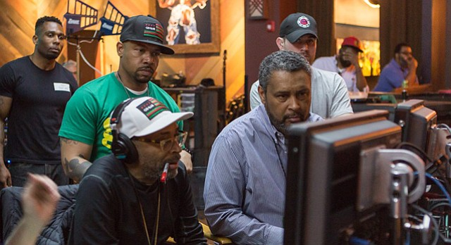 "Director Spike Lee, left, and co-writer and Kansas University professor Kevin Willmott are pictured on set during the filming of 'Chi-Raq' in Chicago in 2015. The film, which opened in limited release in theaters last month, is an adaptation of the classic Greek comedy ""Lysistrata"" about gun violence in present-day Chicago."