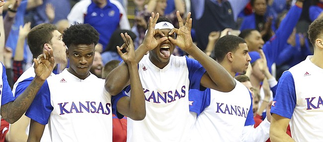 Kansas forward Carlton Bragg Jr. puts up a pair of three goggles as the Jayhawk bench celebrates a three-pointer by Perry Ellis during the second half, Saturday, Dec. 12, 2015 at Sprint Center.