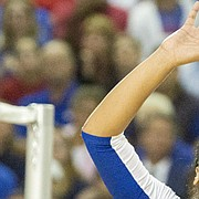 Kansas sophomore Ainise Havili concentrates as she makes a set during the Jayhawks' volleyball match against in-state rival Kansas State Wednesday, Sept. 23, 2015 at the Horejsi Center. The Jayhawks bested the Wildcats, 3-1, and improved to 13-0 on the year.