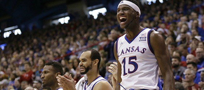 Kansas forward Carlton Bragg Jr. (15) and the Jayhawk bench react to a bucket by forward Landen Lucas during the second half, Saturday, Dec. 19, 2015 at Allen Fieldhouse.