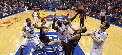 Kansas forward Carlton Bragg Jr. (15) wrestles for a rebound with Montana forward Jack Lopez (31) during the second half, Saturday, Dec. 19, 2015 at Allen Fieldhouse. Also pictured are Kansas forward Landen Lucas (33), Montana forward Fabijan Krslovic (20) and Kansas guard Sviatoslav Mykhailiuk, right.