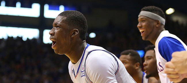 Kansas forward Cheick Diallo (13) and the Jayhawk bench celebrate a bucket and a foul by Kansas forward Landen Lucas (33) during the second half, Saturday, Dec. 5, 2015 at Allen Fieldhouse.