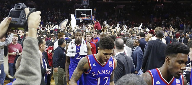 Kansas players leave the court after the Jayhawk's 77-52 loss to the Temple Owls Monday at the Wells Fargo Center in Philadelphia, PA. In the foreground from center are Cliff Alexander (2) Kelly Oubre, Jr. (12) and Jamari Traylor (31).