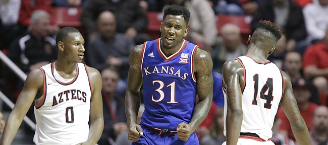 Kansas forward Jamari Traylor (31) celebrates between San Diego State forward Skylar Spencer (0) and forward Zylan Cheatham (14) during a Jayhawk run in the second half, Tuesday, Dec. 22, 2015 at Viejas Arena in San Diego.