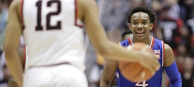 Kansas guard Devonte' Graham (4) flashes a smile during a run by the Jayhawks.