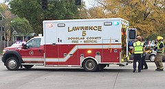 In this photo from Monday, Oct. 27, 2014, members of a Lawrence-Douglas County Fire Medical crew load a cyclist into an ambulance.