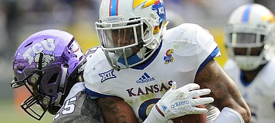 Kansas' Fish Smithson (9) comes up with a interception in the second half of the Jayhawks' 23-17 loss to TCU on Saturday, Nov. 14, 2015, in Fort Worth, Texas.