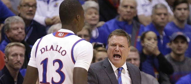 Kansas forward Cheick Diallo (13) gets an earful from head coach Bill Self after a quick foul during the first half, Tuesday, Dec. 29, 2015 at Allen Fieldhouse.