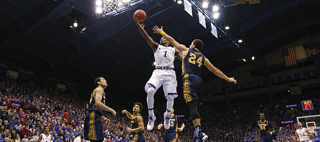 Kansas guard Wayne Selden Jr. (1) floats in for a bucket as he is defended by UC Irvine guard Dominique Dunning (24) during the second half, Tuesday, Dec. 29, 2015 at Allen Fieldhouse.