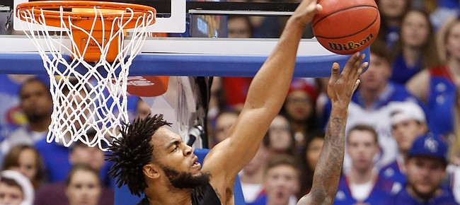 Baylor forward Rico Gathers (2) stuffs a shot from Kansas forward Jamari Traylor during the second half, Saturday, Feb. 14, 2015 at Allen Fieldhouse. In front is Baylor guard Al Freeman (25).