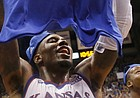Kansas forward Jamari Traylor (31) hoists a Big 12 championship t-shirt after the Jayhawks defeated the West Virginia Mountaineers for their 11th straight league title last March at Allen Fieldhouse.