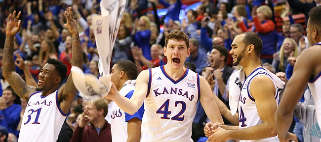Kansas forward Hunter Mickelson (42) and the Jayhawk bench celebrate a three by Lagerald Vick during the second half, Saturday, Jan. 2, 2016 at Allen Fieldhouse.