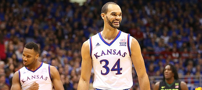 Kansas forward Perry Ellis (34) smiles after some defensive hustle forced a turnover by Baylor during the second half, Saturday, Jan. 2, 2016 at Allen Fieldhouse.