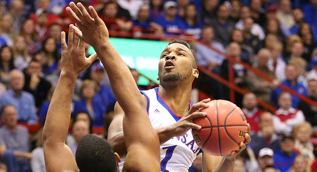 Kansas guard Wayne Selden Jr. (1) hangs for a shot over Baylor forward Rico Gathers (2) during the first half, Saturday, Jan. 2, 2016 at Allen Fieldhouse.