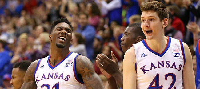 Kansas forward Jamari Traylor (31) and forward Hunter Mickelson (42) celebrate a dunk by teammate Landen Lucas during the second half, Tuesday, Dec. 29, 2015 at Allen Fieldhouse.