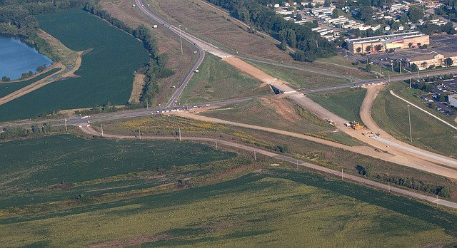 This aerial photo from Sept. 5, 2015 shows the interchange of south Iowa Street and the South Lawrence Trafficway. A shopping center project called KTen Crossing was proposed at the southeast corner of the interchange, below center.
