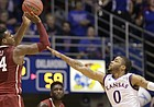 Kansas guard Frank Mason III (0) defends against a three from Oklahoma guard Buddy Hield (24) during the second half, Monday, Jan. 4, 2016 at Allen Fieldhouse.