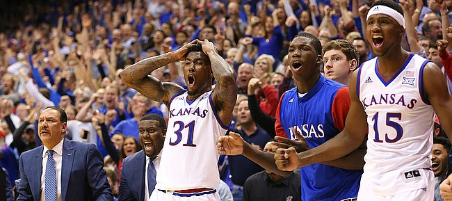 Kansas forward Jamari Traylor (31), forward Cheick Diallo (13) and forward Carlton Bragg Jr. (15) react to an and-one bucket by guard Devonte' Graham (4) to tie the game during the second half, Monday, Jan. 4, 2016 at Allen Fieldhouse.