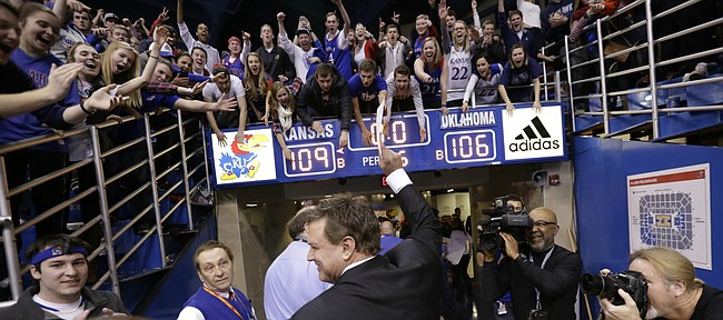 Kansas head coach Bill Self flashes a smile as he leaves the court following the Jayhawks' 109-106 triple overtime win over the Sooners.