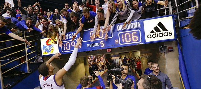 Kansas forward Landen Lucas (33) salutes the fans as he leaves the court following the Jayhawks' 109-106 triple overtime win over the Sooners.
