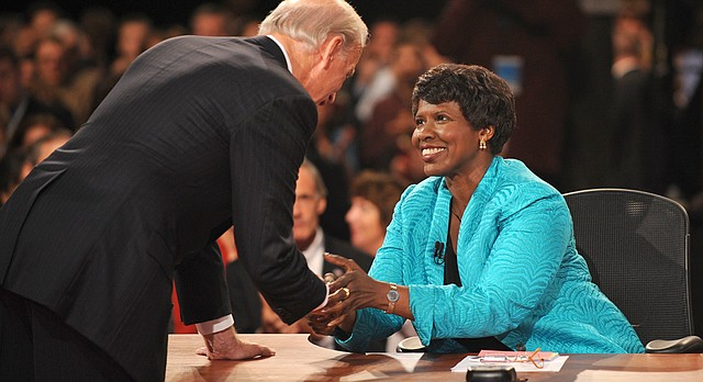 In this file photo from Oct. 2008, PBS journalist and debate moderator Gwen Ifill and Democratic vice presidential nominee, Sen. Joe Biden, D-Del., left, shake hands at the end of his vice presidential debate with Republican rival, Alaska Gov. Sarah Palin (not shown) in St. Louis, Mo.