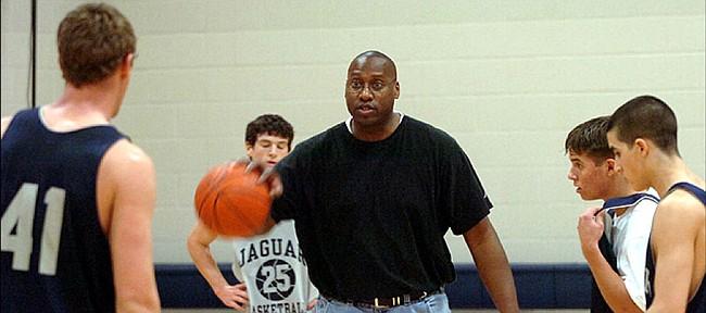 Former Jayhawk basketball player Alonzo Jamison runs a 2006 Mill Valley practice.