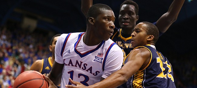 Kansas forward Cheick Diallo (13) looks for an outlet as he is defended by UC Irvine forward Brandon Smith (13) and center Mamadou Ndiaye (34) during the second half, Tuesday, Dec. 29, 2015 at Allen Fieldhouse.