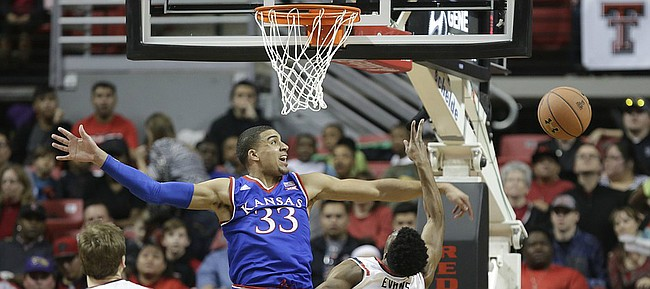 Kansas forward Landen Lucas (33) rejects a shot by Texas Tech guard Keenan Evans (12) but is called for a foul during the first half, Saturday, Jan. 9, 2016 at United Spirit Arena in Lubbock, Texas.