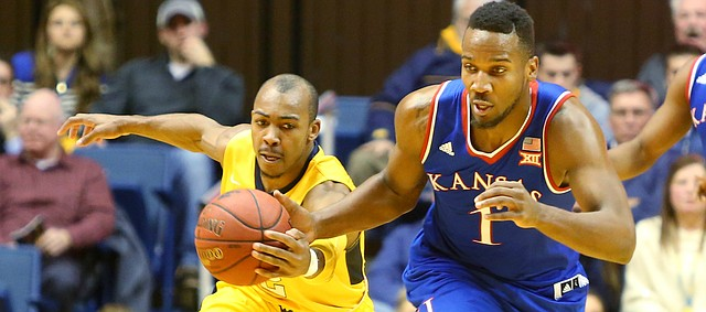West Virginia guard Jevon Carter (2) left, reaches in to steal the ball from a fast-breaking Wayne Selden Jr., (1)  in a game between the Jayhawks and the Mountaineers at the WVU Colliseum in Morgantown, W.V. Tuesday.