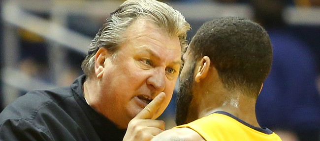 West Virginia coach Bobby Huggins talks to West Virginia guard Jaysean Paige (5), during a break in action in the  Mountaineers 76-63 win over Kansas in Morgantown, W.V. Tuesday.