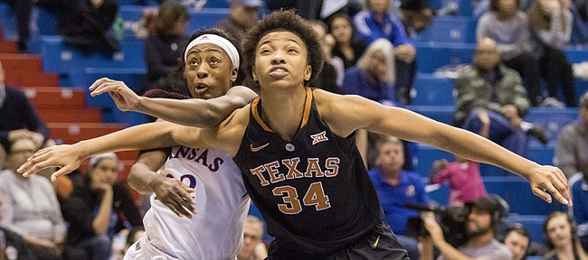 Texas' Imani Boyette (34) boxes out Kansas sophomore Chayla Cheadle as they fight for rebounding position during their game Wednesday evening at Allen Fieldhouse. The Jayhawks dropped their seventh straight game, losing to No. 4 Texas, 75-38.