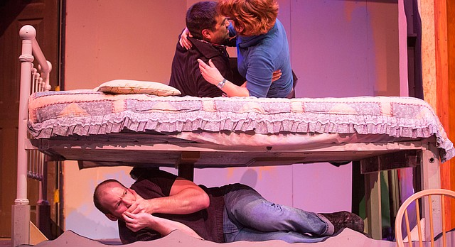"Stephen, played by Christoph Cording, hides under a bed while Rick, played by Mario Bonilla, and Carol, played by Hailey Gillespie, spend some time together during a dress rehearsal Jan. 14 for Theatre Lawrence's upcoming production of ""Girls' Weekend."" The show opens on Jan. 22 with a curtain time of 7:30 p.m. at Theatre Lawrence, 4660 Bauer Farm Dr."
