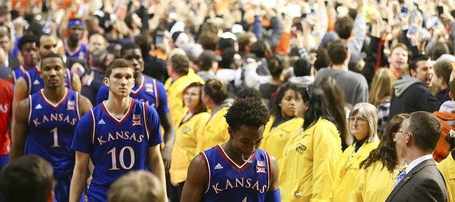 Kansas guard Devonte' Graham and the rest of the Jayhawks leave the floor following their 86-67 loss to Oklahoma State on Tuesday, Jan. 19, 2016 at Gallagher-Iba Arena in Stillwater, Okla.