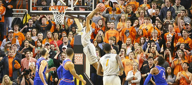 Oklahoma State guard Jeff Newberry (22) pulls back for a two-handed jam before several Kansas players during the second half, Tuesday, Jan. 19, 2016 at Gallagher-Iba Arena in Stillwater, Okla.